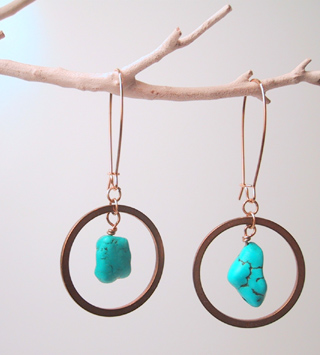Turquoise suspended in brass rings