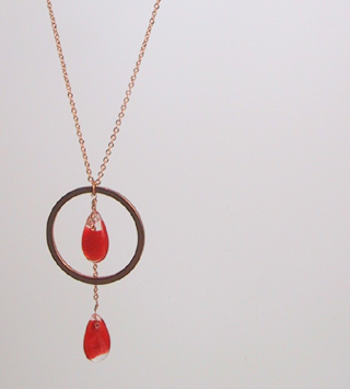 Red swirl teardrops with brass ring
