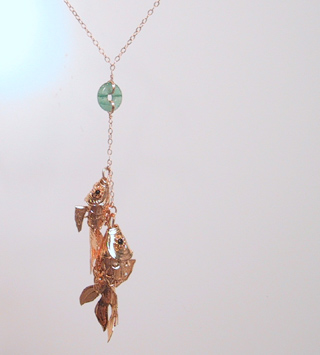 Gold fish with green aventurine